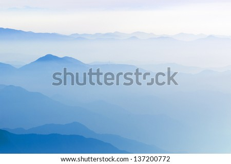 scenic foggy mountain ridges in Japan by early morning - stock photo