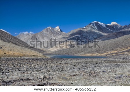 Scenic lake in rocky valley in Pamir mountains in Tajikistan - stock photo