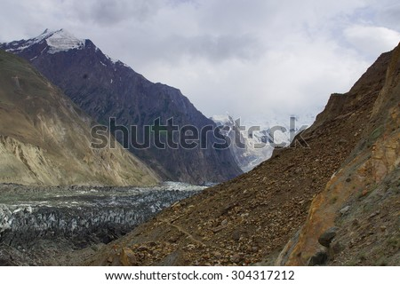 Scenic landscape - Hoper Glacier and the Golden Peak - Elevation 7,027 m - stock photo