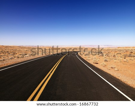 Scenic landscape of desert highway in rural Arizona, United States. - stock photo