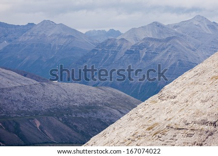 Scenic landscape of high mountain ridges and peaks alpine terrain of Northern Canadian Rocky Mountains, British Columbia, Canada - stock photo