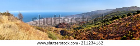 scenic landscape of mountain valley with blue sky, white clouds and colorful houses (Tenerife, Canary islands, Spain) - stock photo