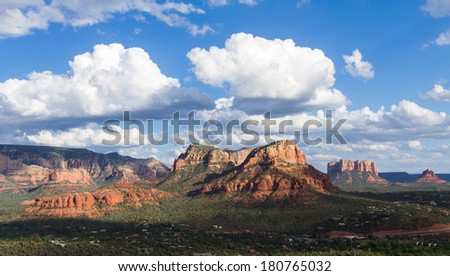 Scenic landscape view of the Sedona area in the summer months with the Red Rock formation in the distance - stock photo