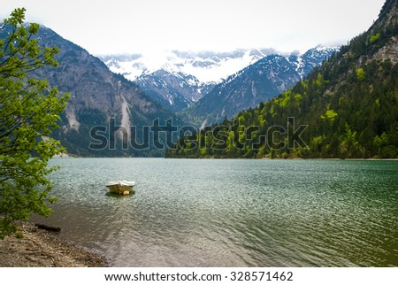 Scenic landscape with lake and boat in Bavaria, Germany
