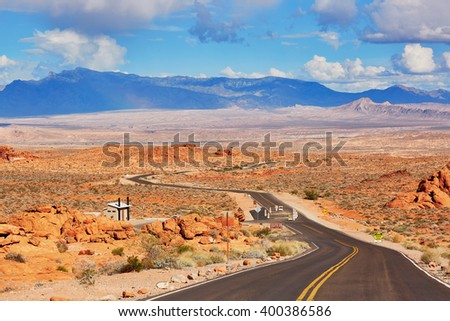 Scenic landscape with winding road in Valley of the Fire  park in Nevada, USA