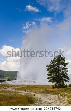 Scenic Landscapes of Geothermal activity of Yellowstone National Park USA - Old Faithful Geyser - stock photo