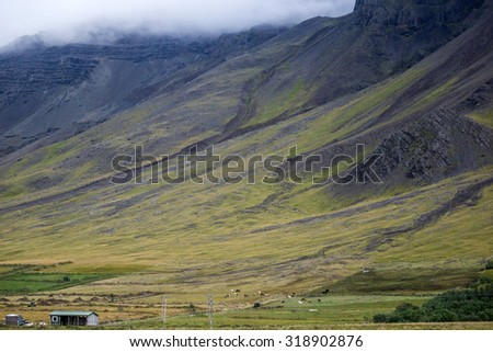 scenic landscapes of grass covered mountain and hills in the summer in Iceland - stock photo