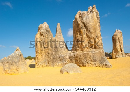 Scenic limestone rock formation Pinnacles in remote outback sandy desert of Nambung National Park, Western Australia, north of state capital Perth, summer sunny blue sky.