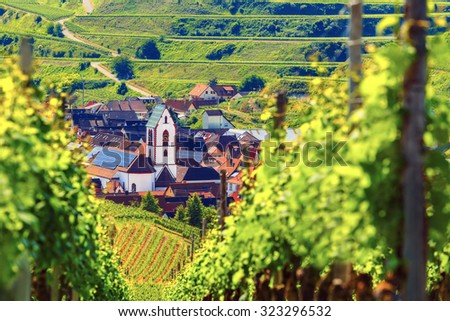 Scenic mountain landscape with vineyards growing on hills and old picturesque town in Germany, Black forest, Kaiserstuhl. Travel and wine-making background. - stock photo