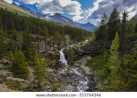Scenic Mountain river and waterfalls, Waterton National Park Alberta Canada - stock photo
