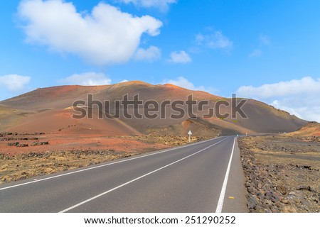 Scenic mountain road in Timanfaya National Park, Lanzarote, Canary Islands, Spain - stock photo