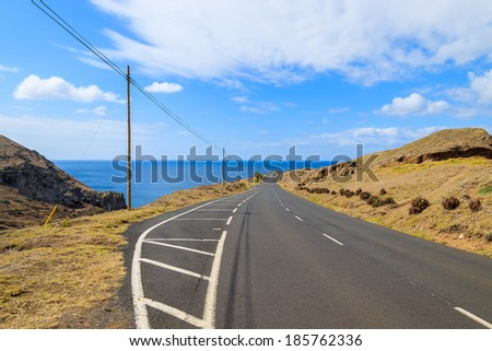 Scenic mountain road on Sao Lourenco peninsula with ocean in the background, Madeira island, Portugal - stock photo