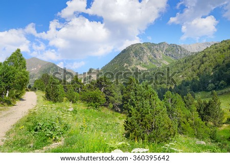 scenic mountains, meadows and blue sky - stock photo