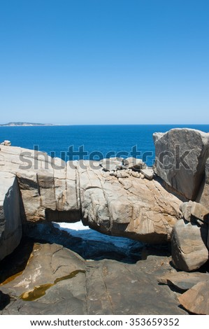 Scenic Natural Bridge rock formation in Torndirrup National Park, Albany, Western Australia, with cliff coast and Southern Ocean, blue sky, copy space. - stock photo