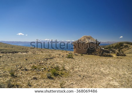 Scenic old hut on Isla del Sol, island on lake Titicaca in Bolivia - stock photo