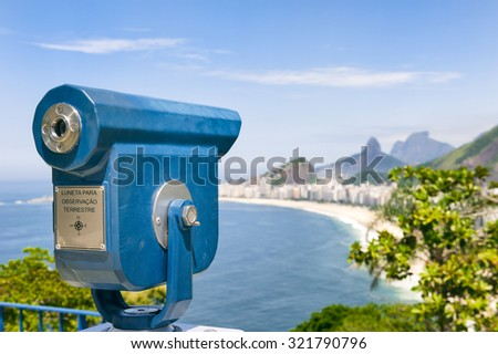 Scenic overlook view of Copacabana Beach in Rio de Janeiro, Brazil with a telescope [English translation of sign: Telescope for viewing of landscape] - stock photo