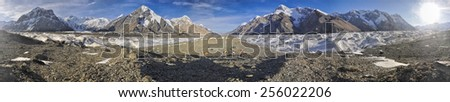 Scenic panorama of campsite on Engilchek glacier in picturesque Tian Shan mountain range in Kyrgyzstan - stock photo