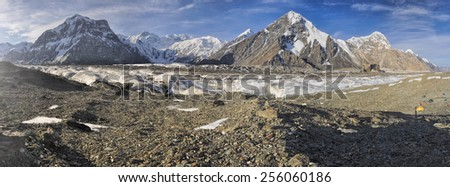 Scenic panorama of Engilchek glacier in picturesque Tian Shan mountain range in Kyrgyzstan - stock photo