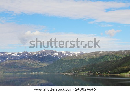 Scenic panorama of fjord and mountains in northern Norway - stock photo