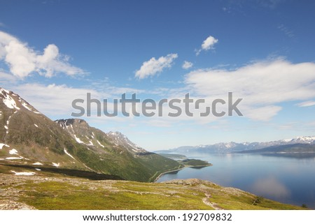Scenic panorama of fjord on in northern Norway on sunny summer day - stock photo