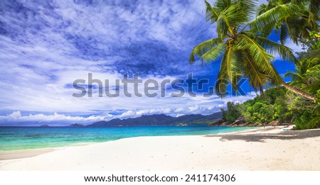 scenic panorama one of the beautiful beaches in Seychelles island - stock photo
