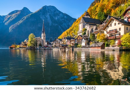 Scenic panoramic picture-postcard view of famous Hallstatt mountain village with Hallstatter See in the Austrian Alps in beautiful golden morning light in fall, Salzkammergut, Austria - stock photo