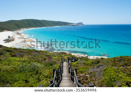Scenic panoramic view of cliff coast and Cable Beach at Torndirrup National Park, Albany, Western Australia, wild Southern Ocean, blue sky, copy space. - stock photo
