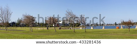 Scenic panoramic view of the green  park lands from the cycleway of  the Leschenault Estuary  in Bunbury, Western Australia on a sunny afternoon in early winter.