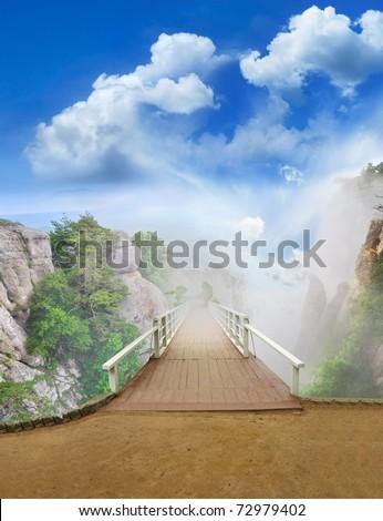 scenic park wooden bridge, view of the mountain fog. - stock photo