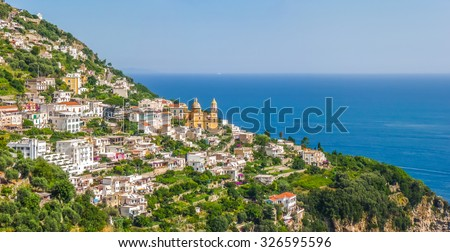 Scenic picture-postcard view of famous Amalfi Coast with Gulf of Salerno in beautiful evening light, Campania, Italy