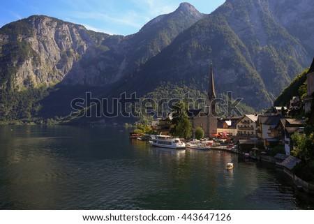 Scenic picture-postcard view of famous Hallstatt mountain village with Hallstaetter Lake in the Austrian Alps, region of Salzkammergut, Austria - stock photo