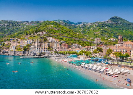 Scenic picture-postcard view of the beautiful town of Minori at famous Amalfi Coast with Gulf of Salerno on a sunny day with blue sky and clouds in summer, Campania, Italy - stock photo