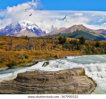 "Scenic powerful and high-water waterfall ""Cascades Paine."" National Park Torres del Paine in southern Chile - stock photo"