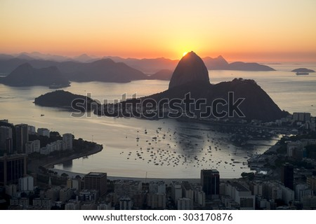Scenic Rio de Janeiro Brazil golden sunrise over Guanabara Bay with a skyline silhouette of Sugarloaf Mountain - stock photo