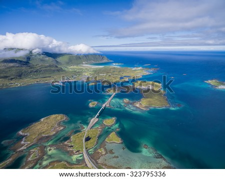 Scenic road bridges connecting islands on Lofoten in Norway, seen from air - stock photo