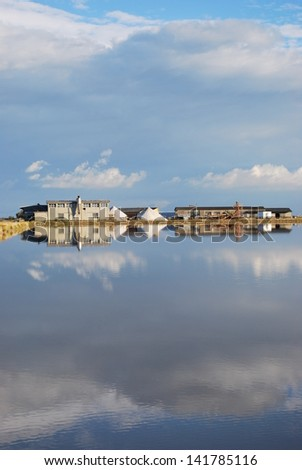 Scenic salt pan and water reflections, Cervia, Ravenna, Italy - stock photo