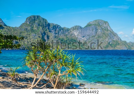 Scenic sea shore with mountains, Palawan, Philippines - stock photo