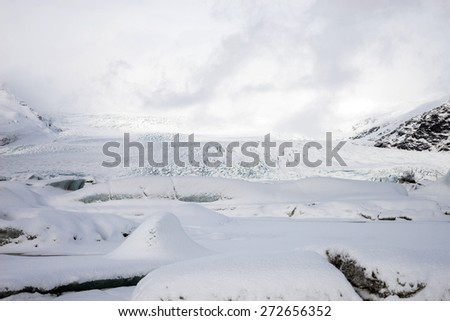 scenic snow covered mountains and glaciers of the Fjallsarlon Glacier in Iceland.  - stock photo