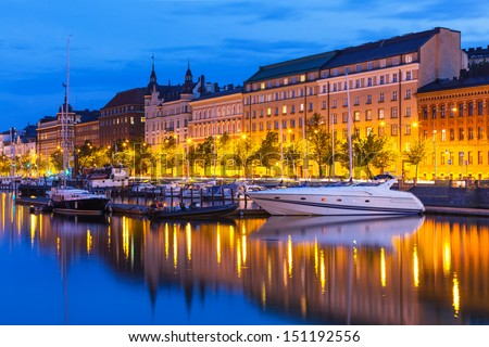 Scenic summer evening view of the Old Town pier with sailing yachts and ships in Helsinki, Finland - stock photo