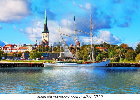 Scenic summer panorama of pier with historical tall sailing ship in the Old Town in Tallinn, Estonia - stock photo