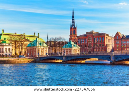 Scenic summer panorama of the Old Town (Gamla Stan) architecture pier in Stockholm, Sweden - stock photo