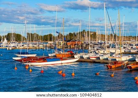 Scenic summer view of harbor with yachts in sunset in Helsinki, Finland - stock photo