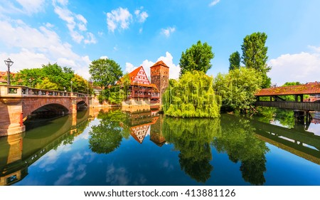 Scenic summer view of the German traditional medieval half-timbered Old Town architecture and bridge over Pegnitz river in Nuremberg, Germany - stock photo