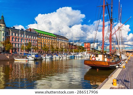 Scenic summer view of the Old Port pier architecture with ships, yachts and other boats in the Old Town of Helsinki, Finland - stock photo