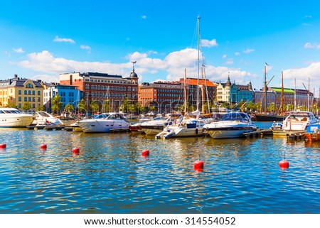 Scenic summer view of the Old Town architecture and pier with yachts and boats in the Old Port in Helsinki, Finland - stock photo