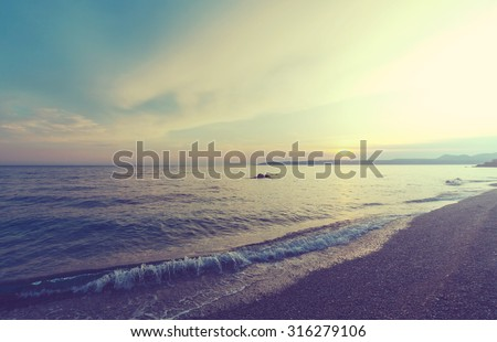 Scenic sunset at the sea - stock photo