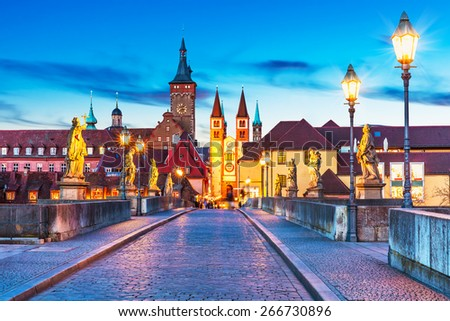 Scenic sunset evening view of the Old Main Bridge over the Main river in the Old Town of Wurzburg, Bavaria, Germany - stock photo