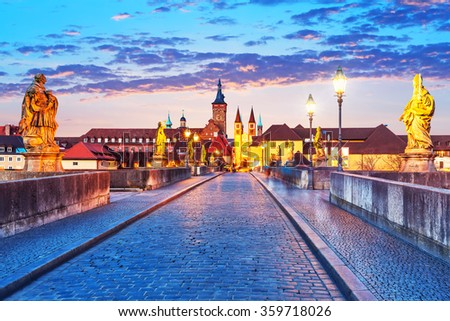 Scenic sunset evening view of the Old Main Bridge over the Main river in the Old Town of Wurzburg, Bavaria, Germany
