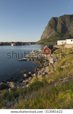 Scenic town of Reine by the fjord on Lofoten Islands in Norway. - stock photo