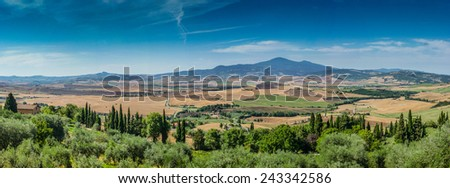 Scenic Tuscany landscape panorama with rolling hills and harvest fields from the old town Pienza, Val d'Orcia, Italy - stock photo